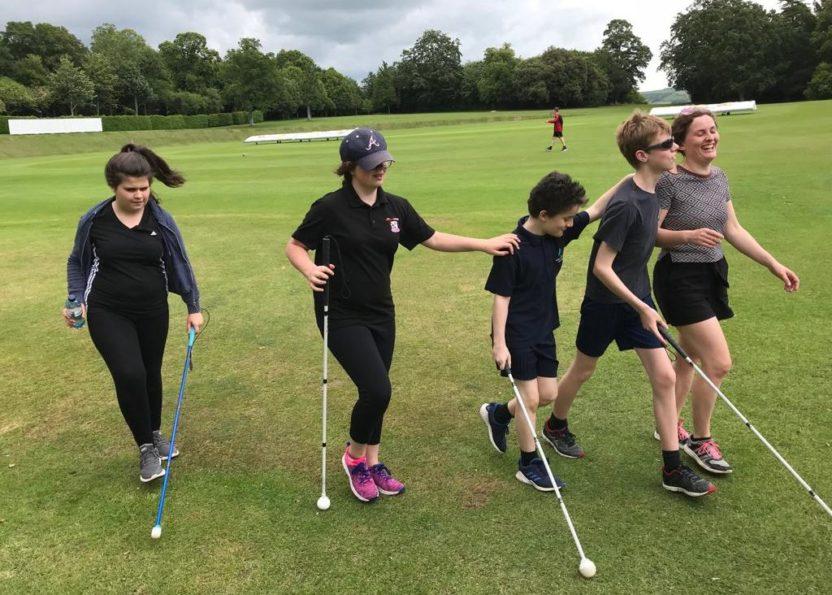5 kids with blind navigation sticks